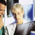 Two doctors consulting an xray